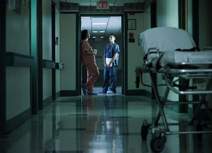 Hospital doctors in corridor at night