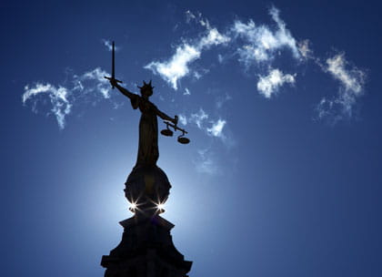 Justice statue silhouetted on Old Bailey