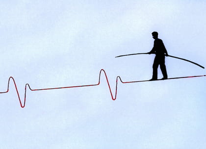 Graphic of doctor walking on cardiogram tightrope