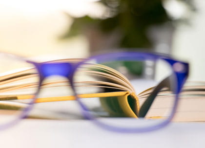 Glasses and book - concept of clarity